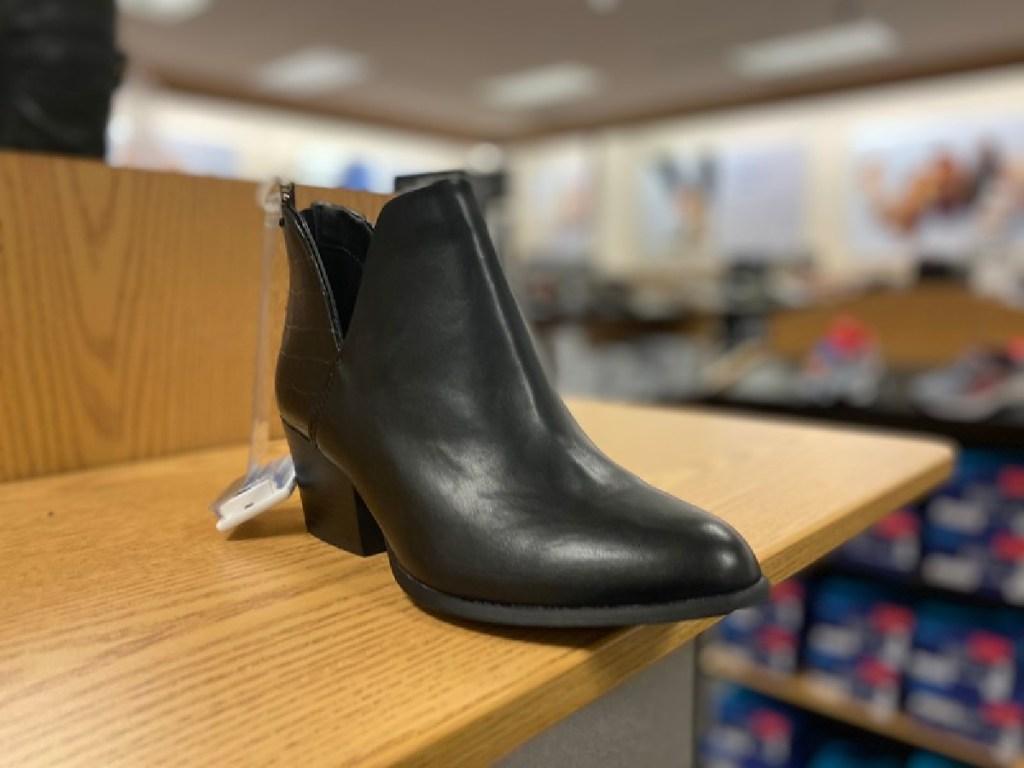 black booties on display in store