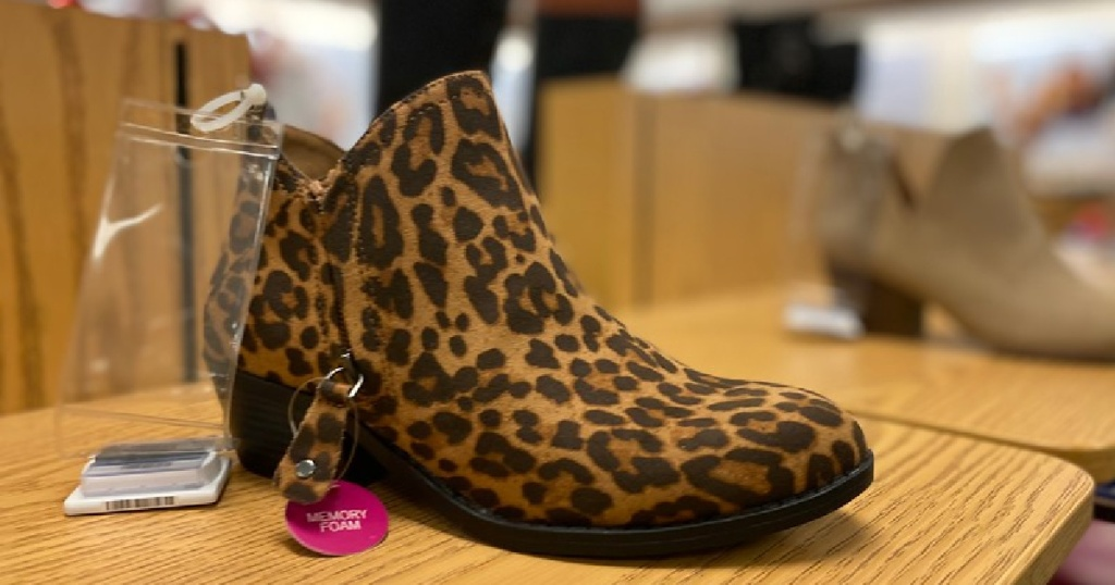 leopard booties on display in store