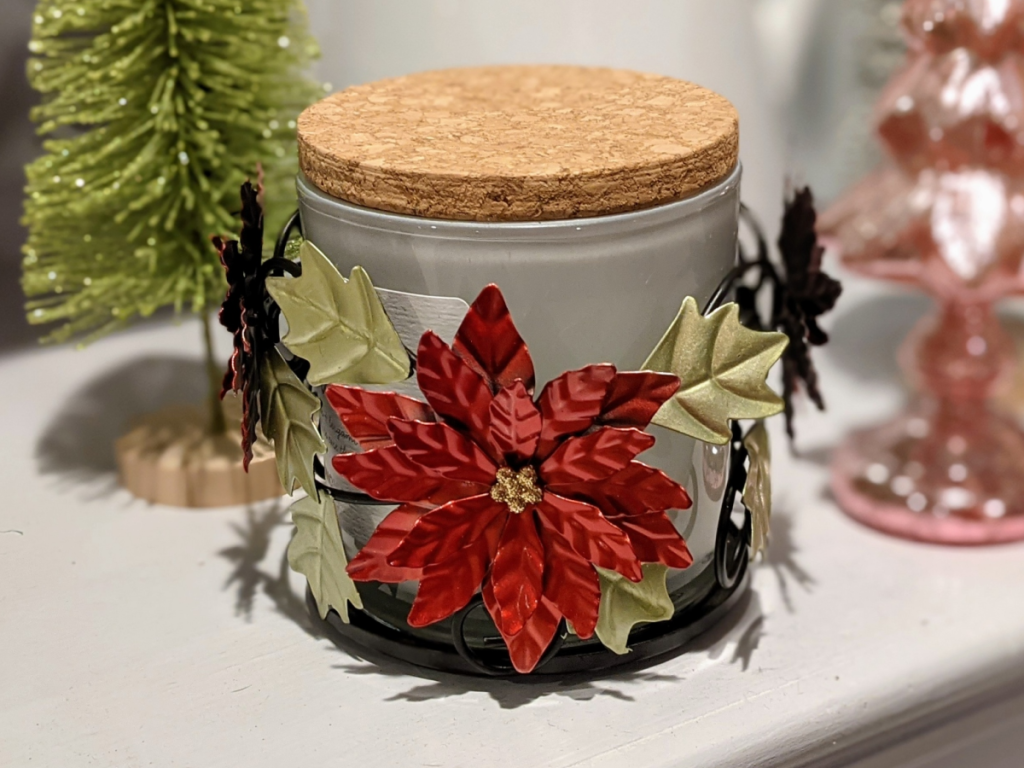 candle holder with poinsettias on it