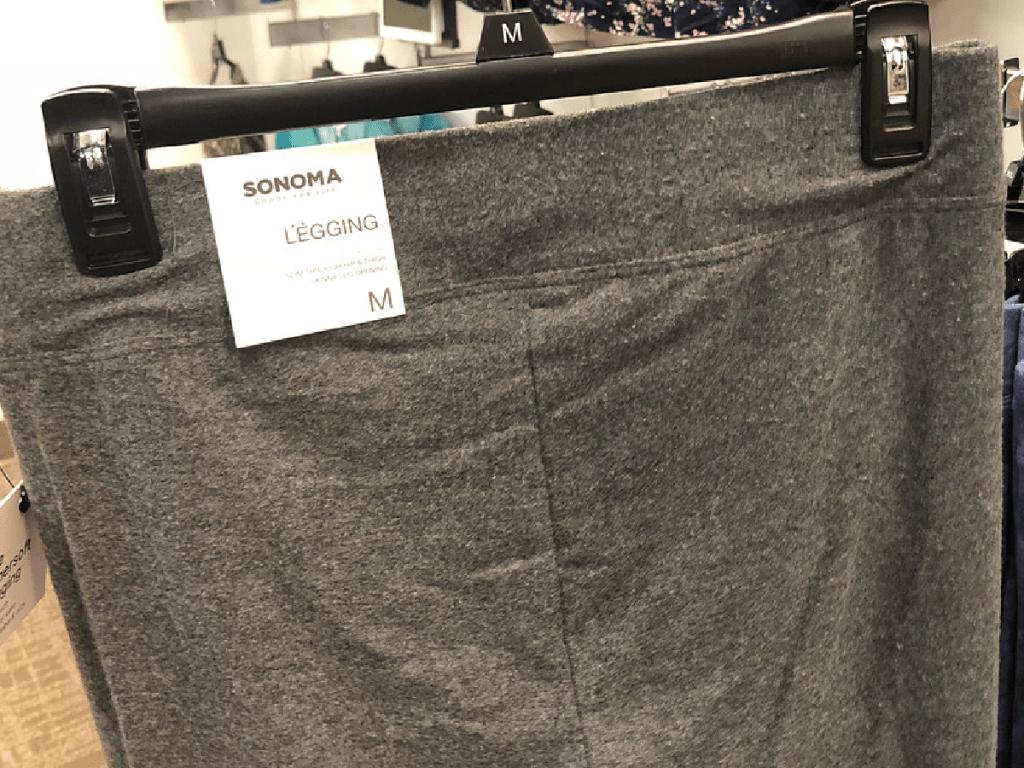 pair of grey leggings on hanger in store