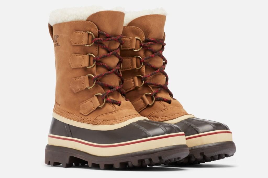 pasangan sepatu bot dewasa sorel karibu