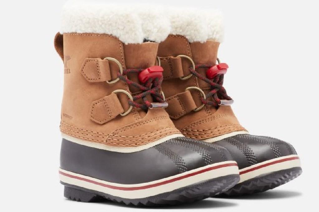 sorel caribou kids boots pair