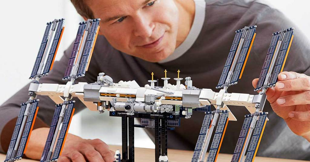 man working on a lego build space station