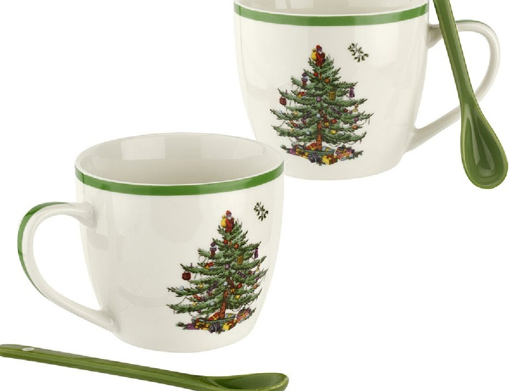 2 christmas themed mugs with green ceramic spoons