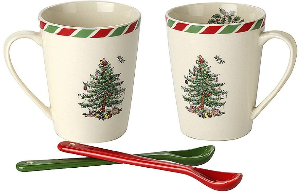 2 mugs with Christmas trees on them next to ceramic spoons
