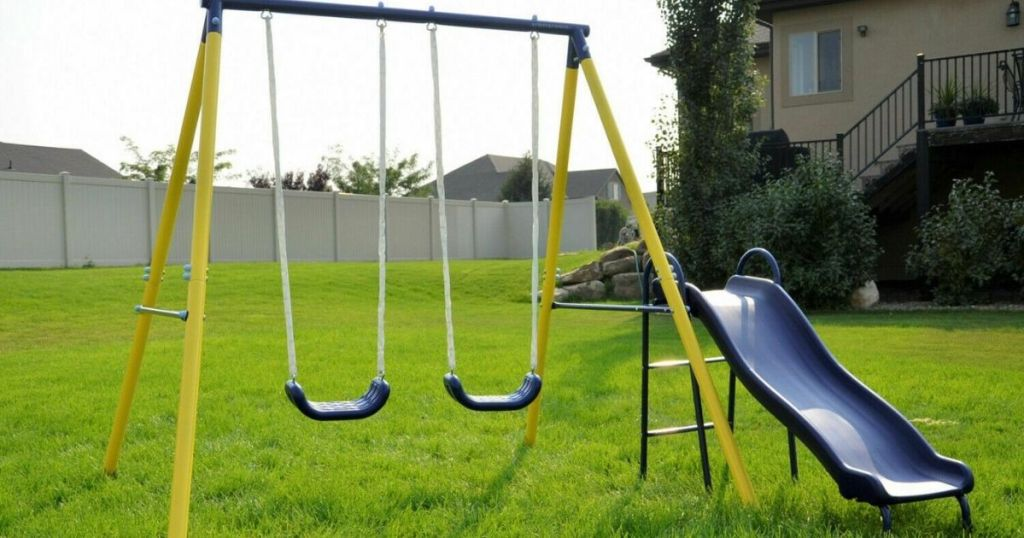 blue and yellow swing set and slide
