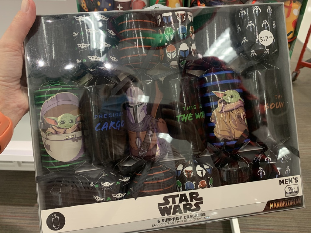 hand holding package of socks themed from Star Wars