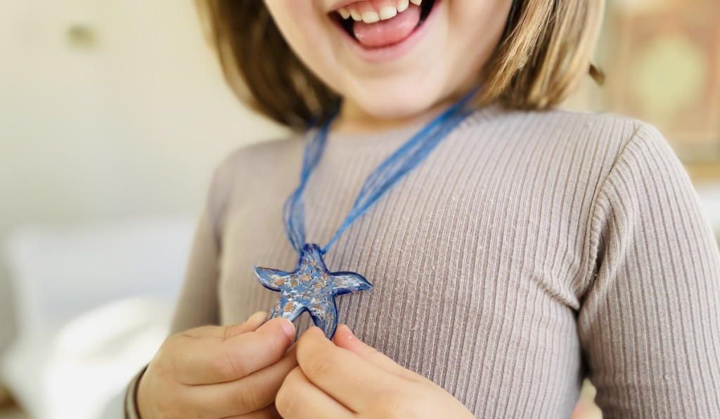 starfish project lisa necklace on little girl