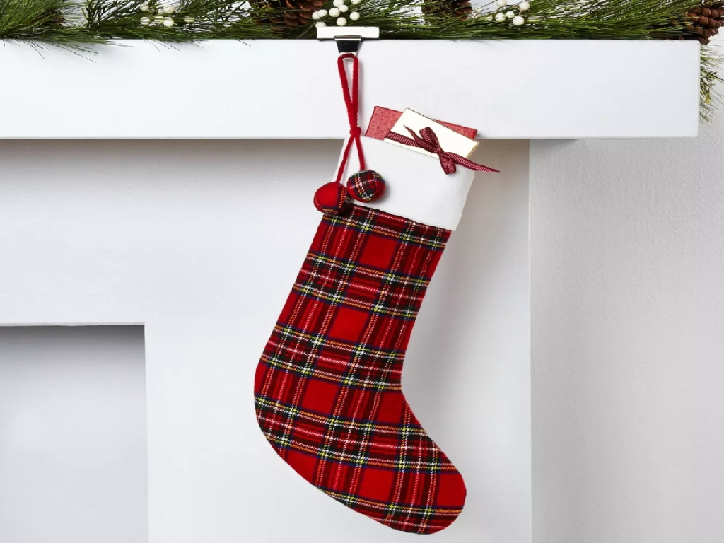 pretty christmas stocking by fireplace