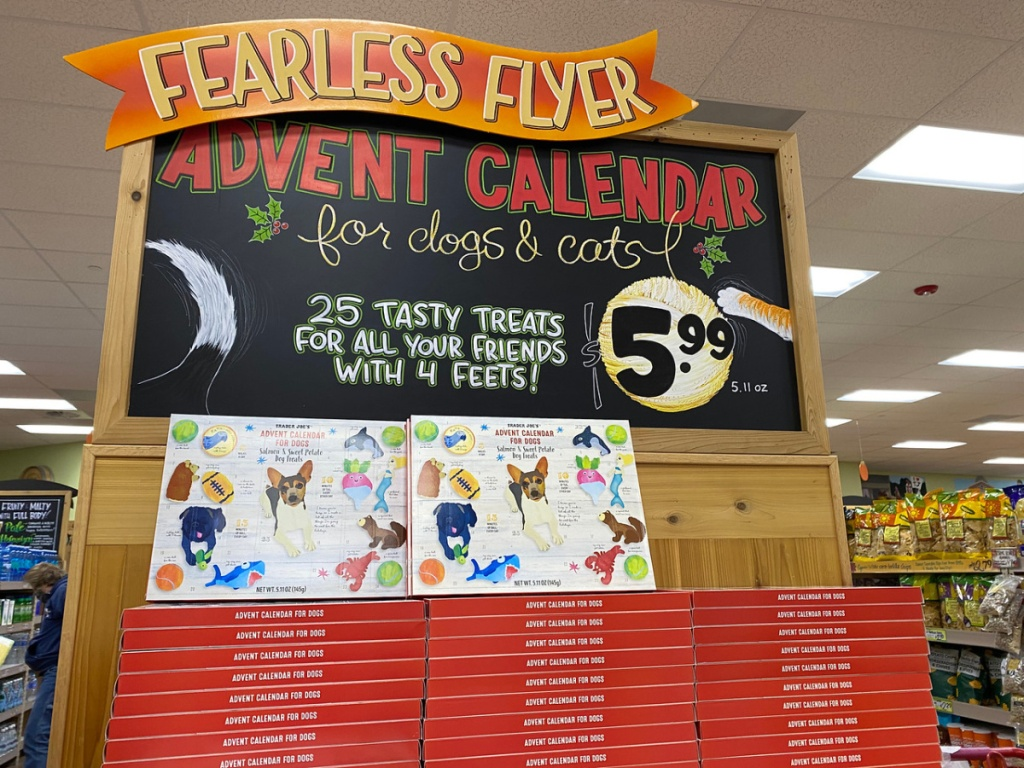 store sign with stacks of pet advent calendars