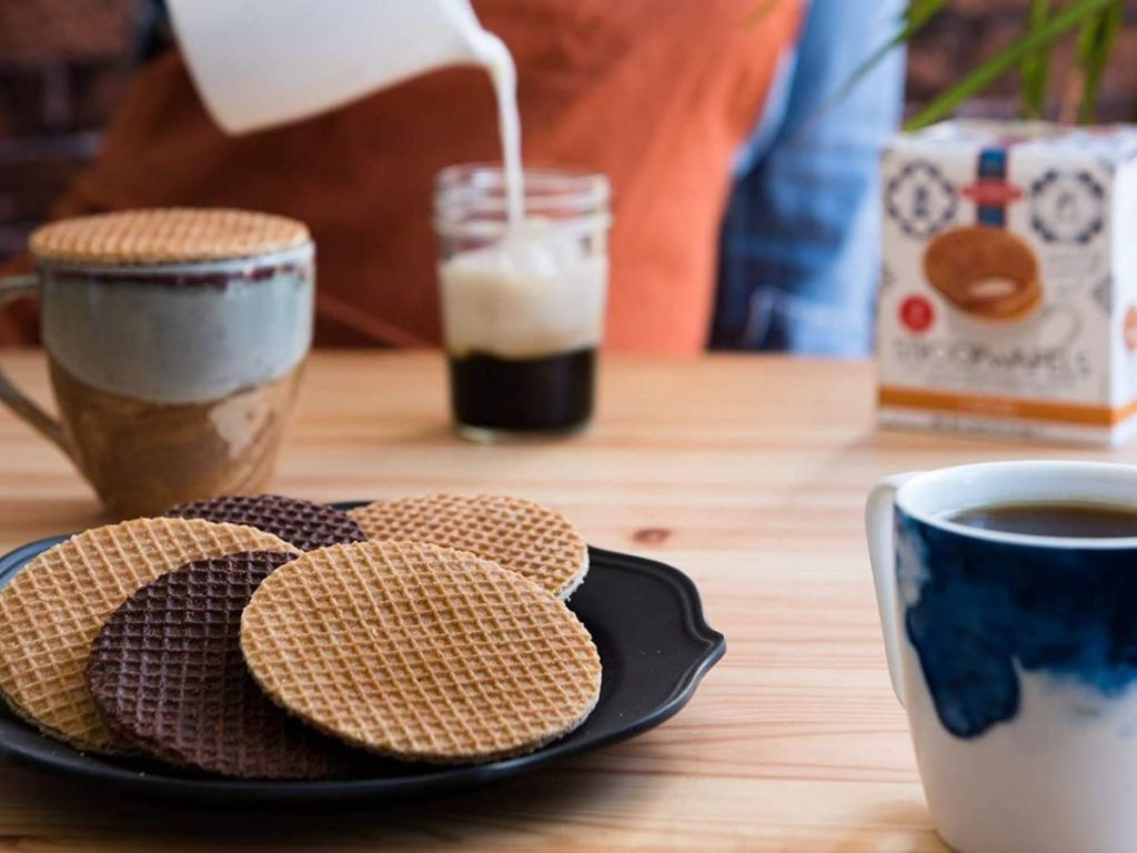 stroopwafels on plate with coffee in background