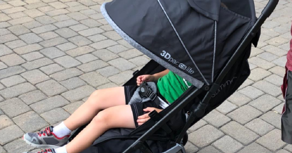 stroller outside with small child in it