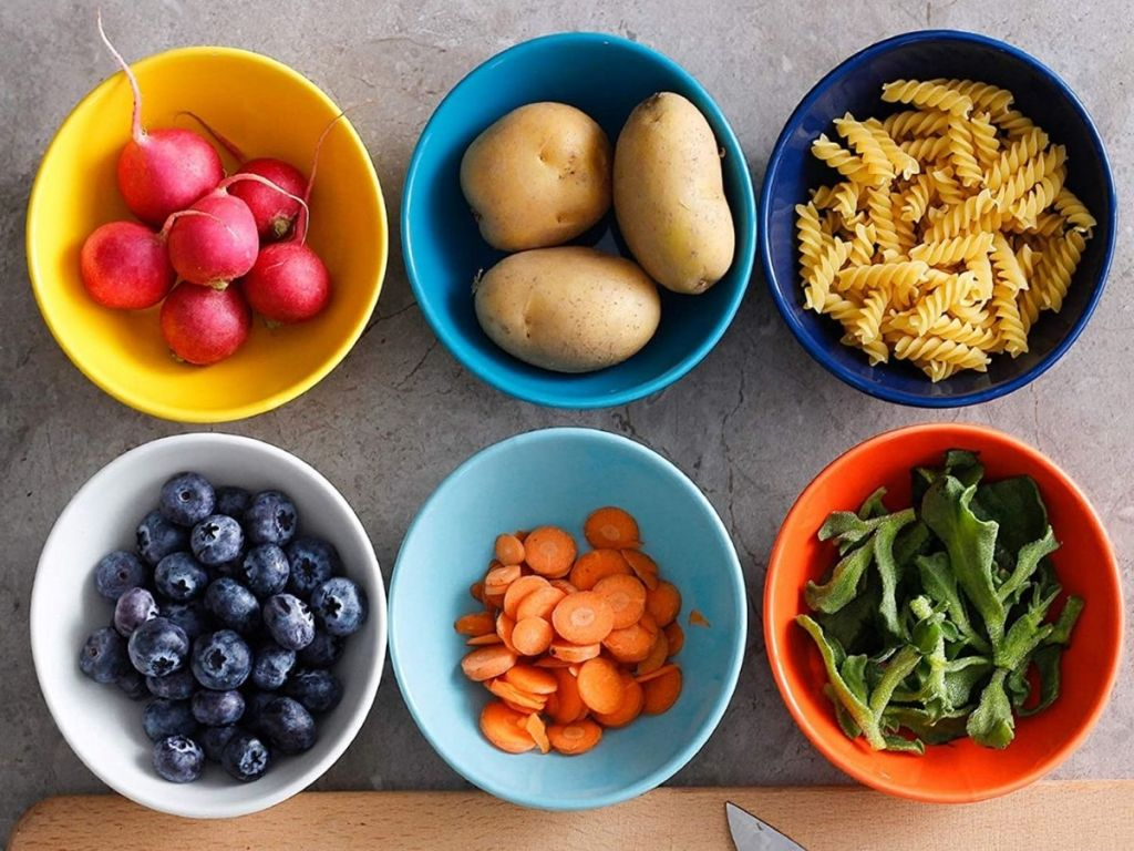colorful bowls with food in each bowl