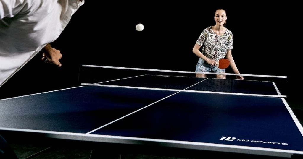 woman and man playing table tennis