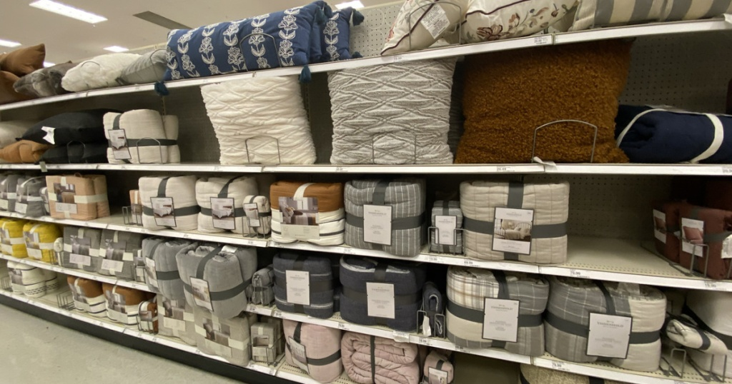 store shelf with pillows and blankets