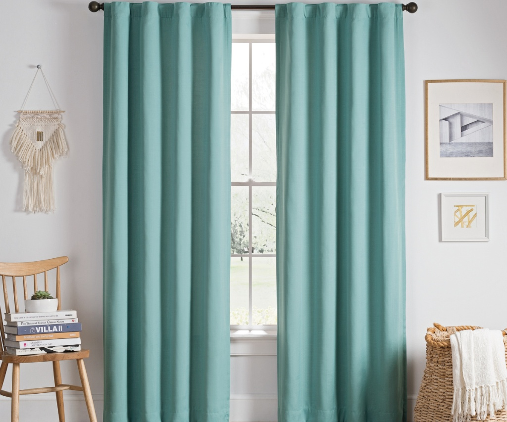 two teal curtains near window
