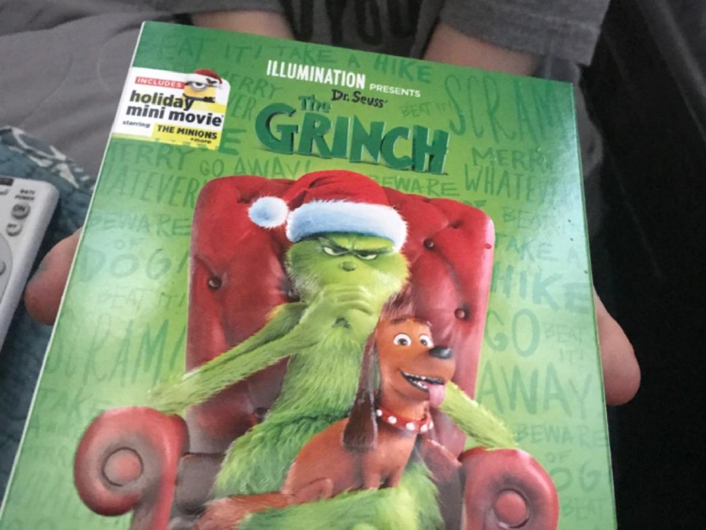 the grinch dvd in hand
