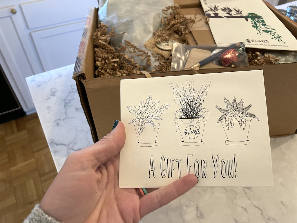 holding the gift for you card from Plant Subscription Box