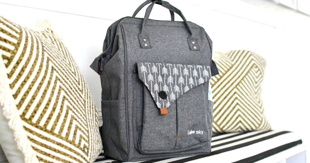 grey travel backpack sitting on entry bench