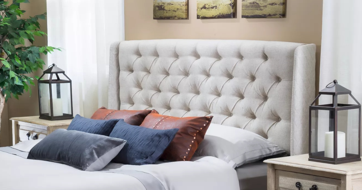 tufted headboard with made bed and nightstand