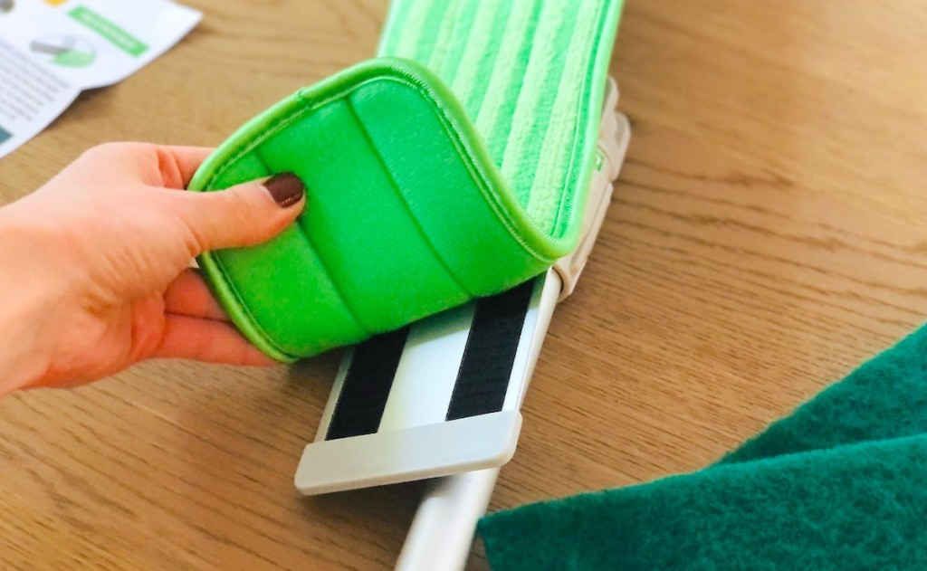 hand holding green turbo mop pad