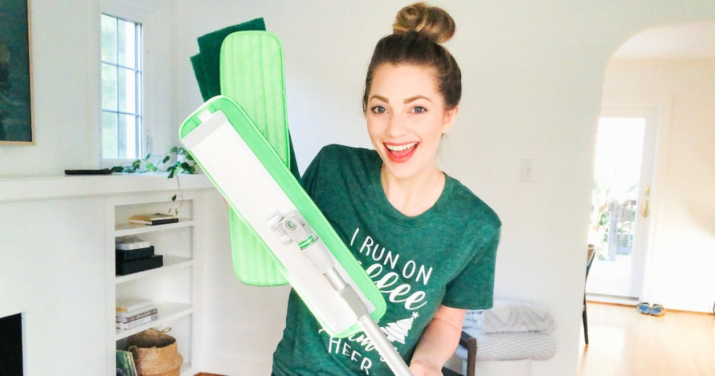woman holding green turbo mop with extra pads