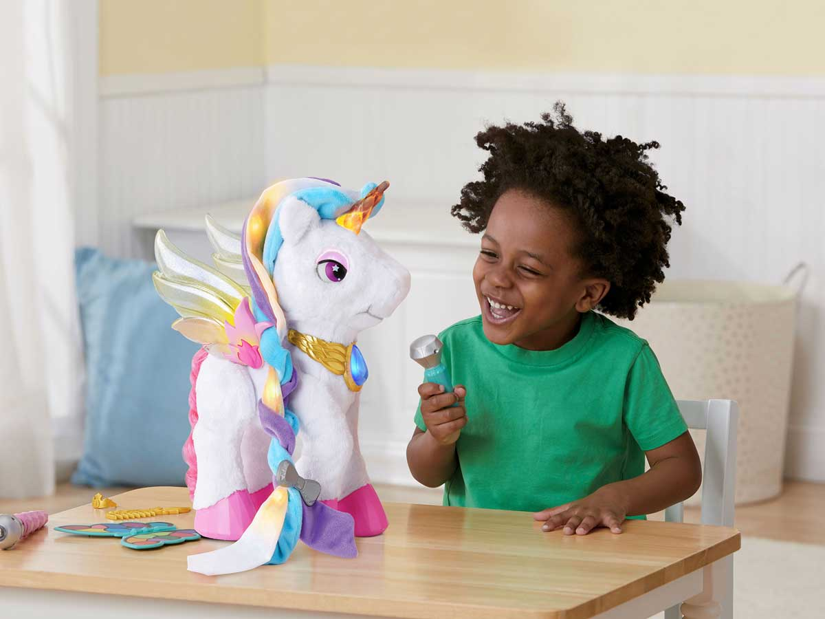 little girl playing with a unicorn