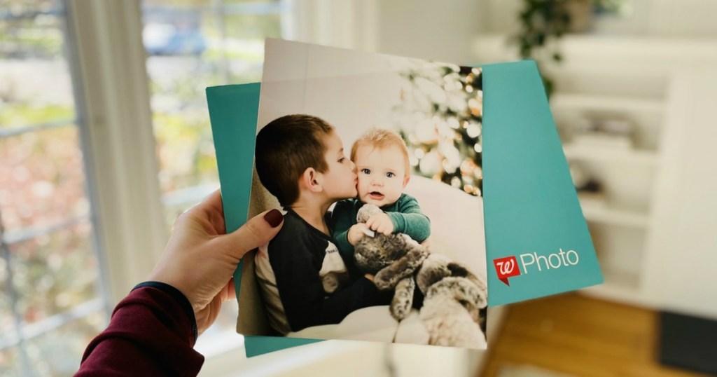 woman holding walgreens photo print and envelope