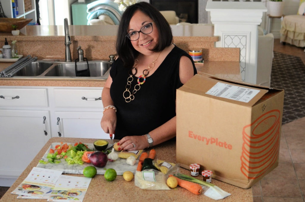 woman cutting vegetables from everyplate package