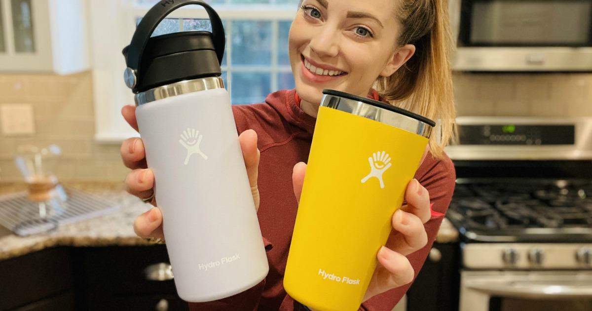 woman holding Hydro Flask bottles