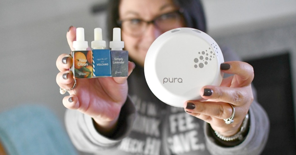 woman holding a pura with refills