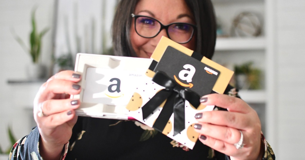 woman holding amazon gift cards