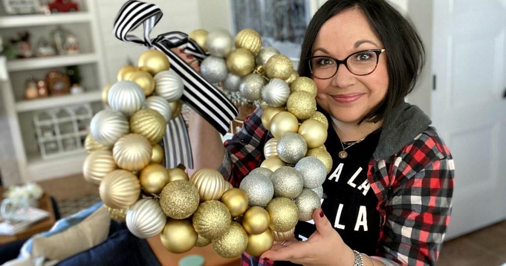 woman holding an ornament wreath