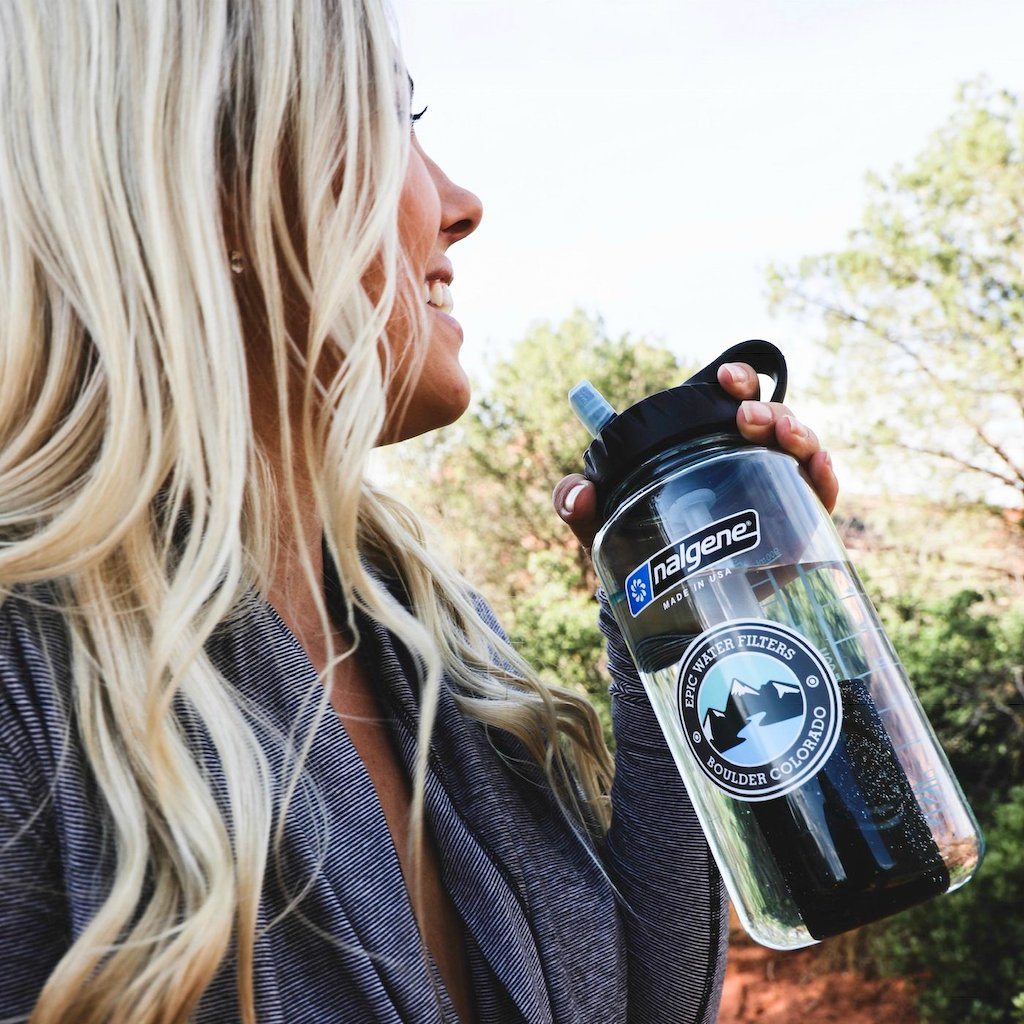 woman holding epic Nalgene water bottle
