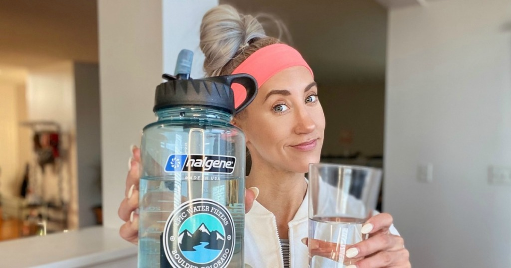 woman holding Epic Nalgene water bottle with filter