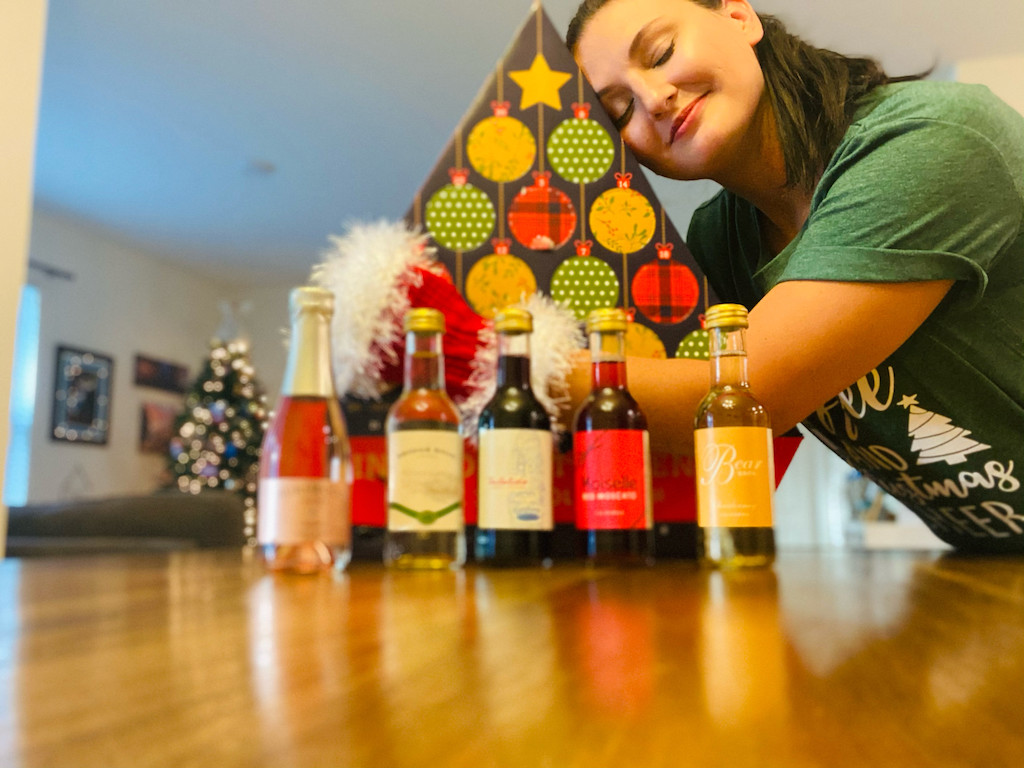 woman hugging wine advent calendar from ALDI
