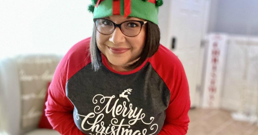 Woman wearing Christmas tee and Christmas hat