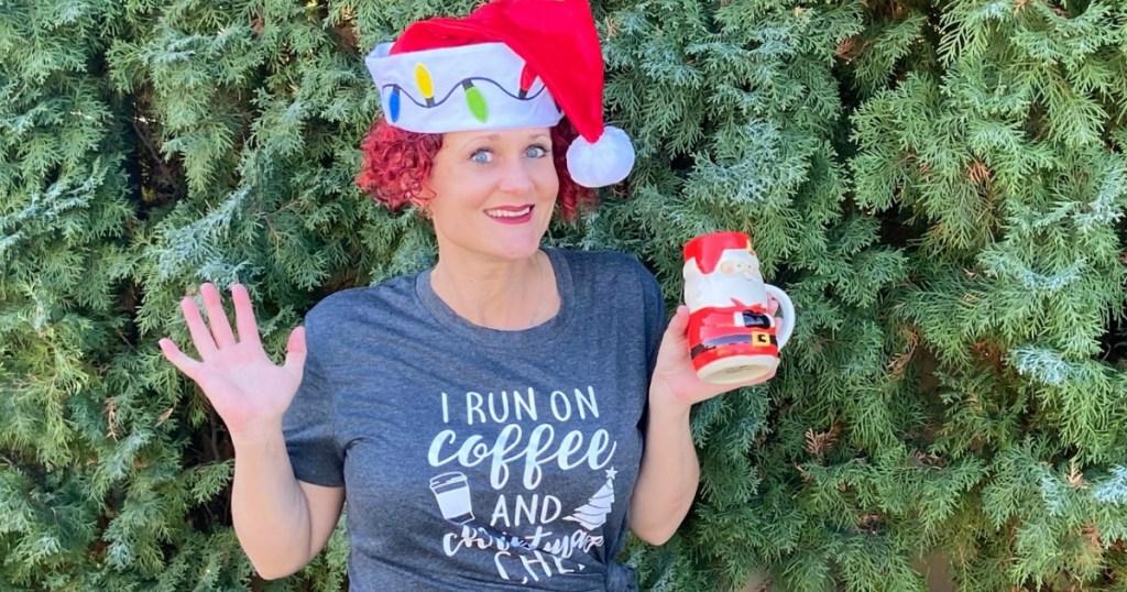 woman wearing Santa hat with festive mug