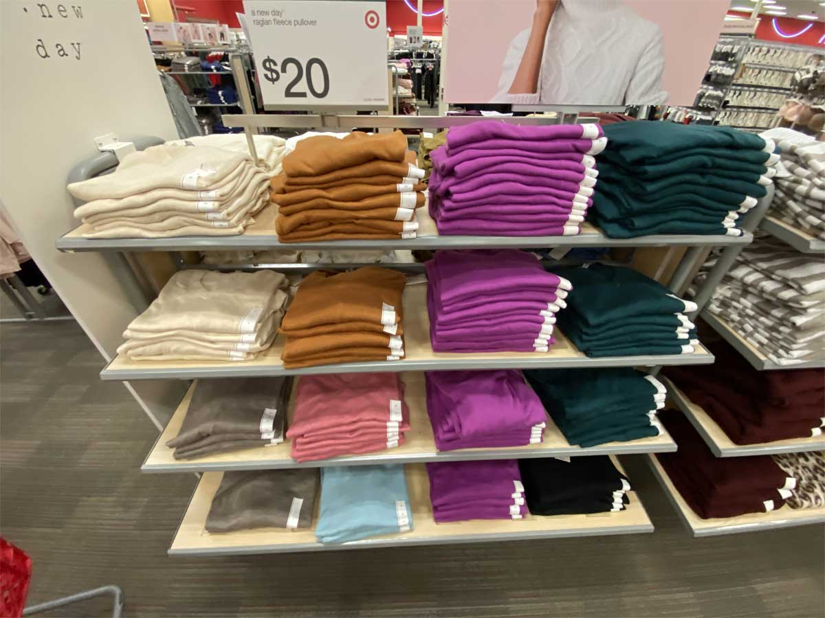 folded women's shirts on display in a store