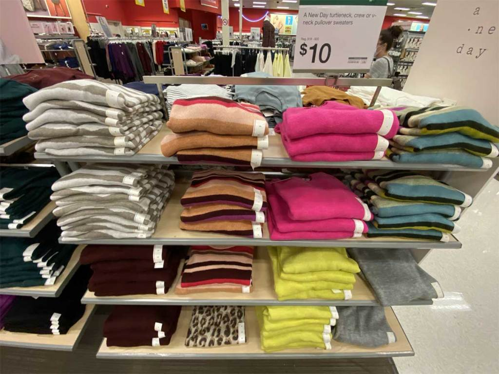 women's sweaters on display in store