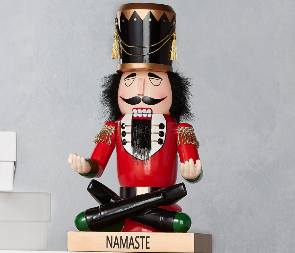 "nutcracker doing yoga with ""namaste"" written on base"