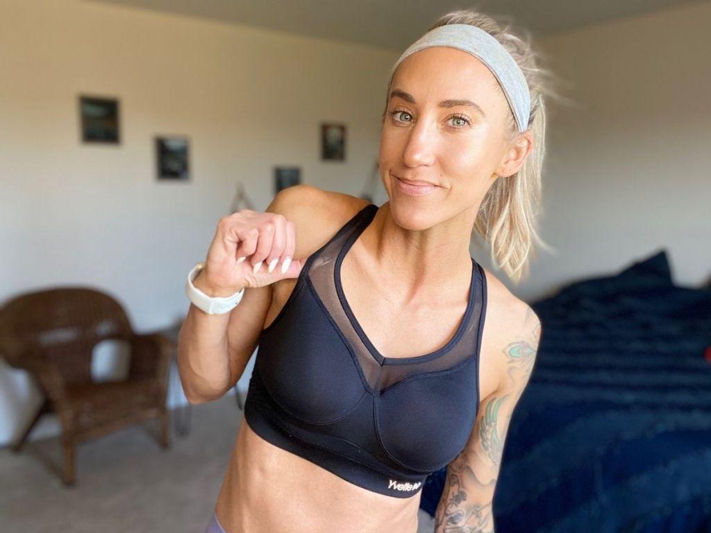 woman wearing navy sports bra