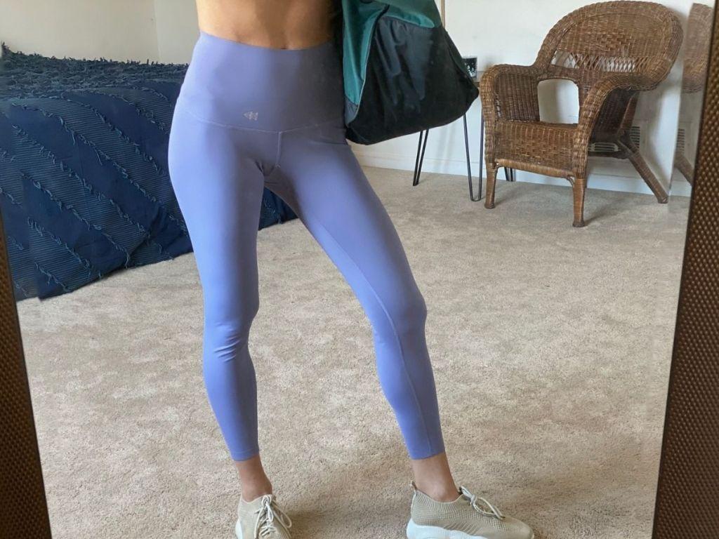 woman wearing purple leggings