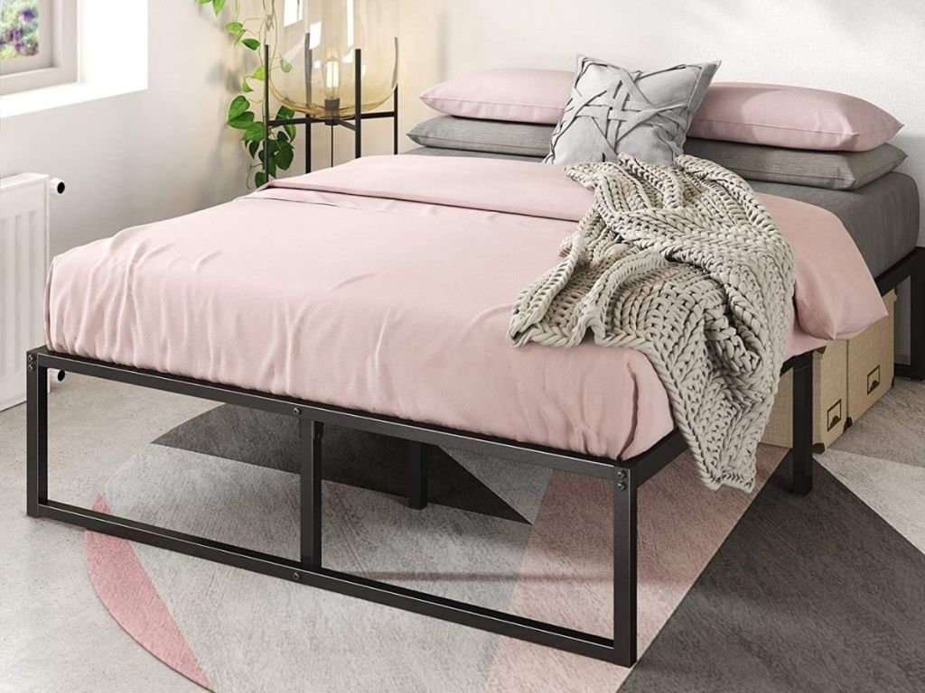 metal frame with mattress on it in bedroom