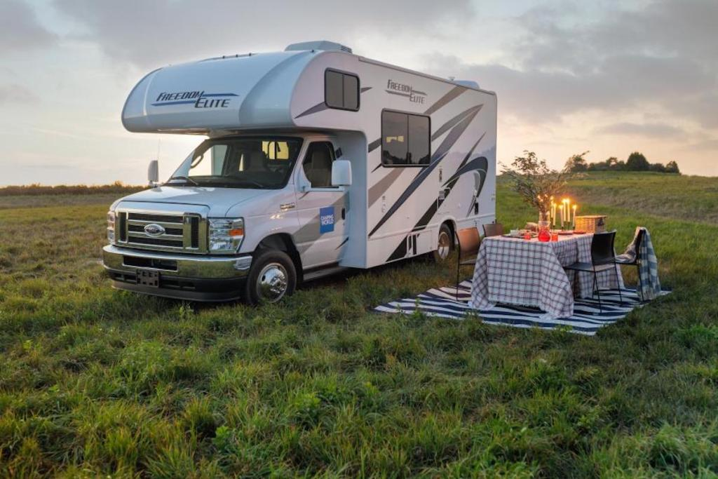 2021 Freedom Elite 22HEF motorhome parked in the grass with picnic
