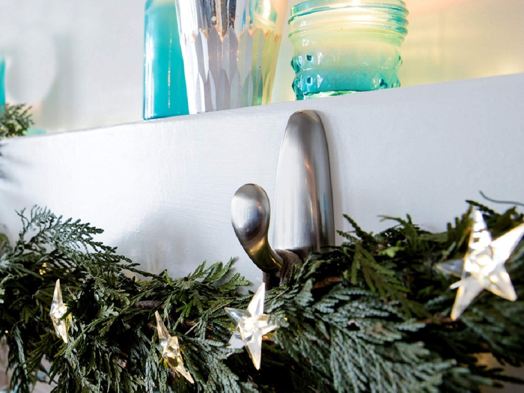 silver command hook holding green ferns