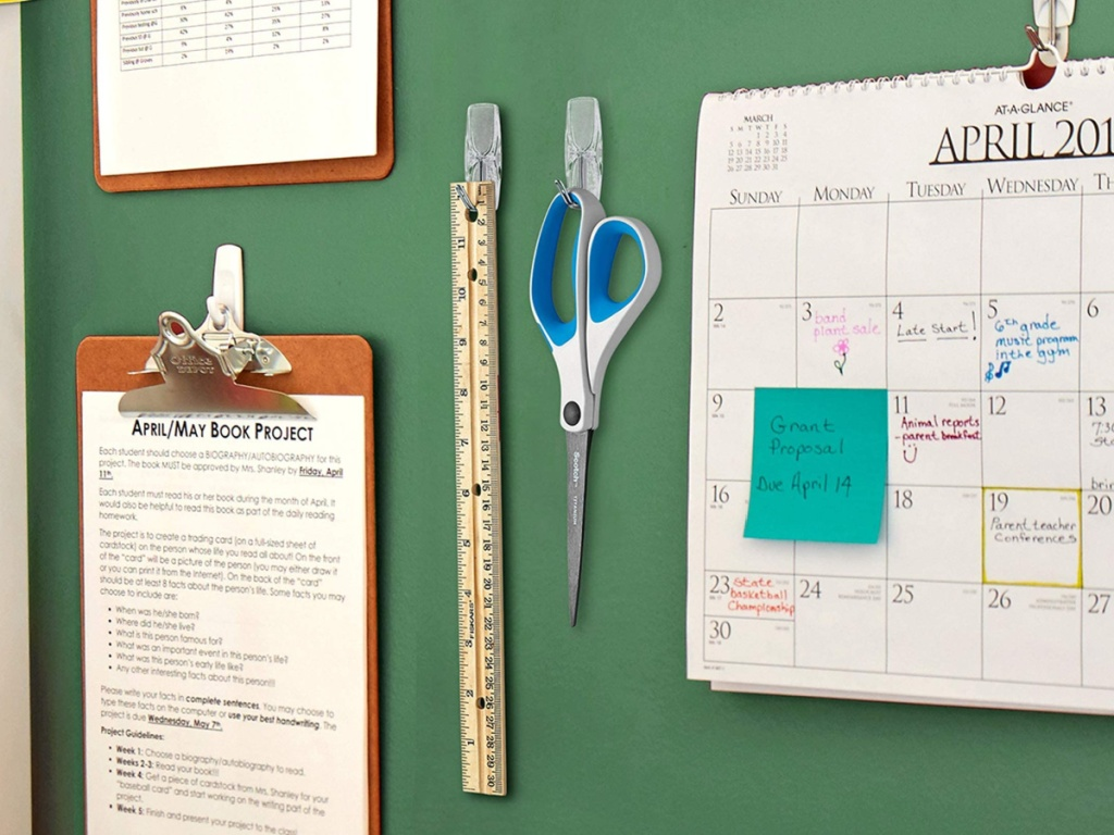 scissors and ruler hanging from command toggle hooks