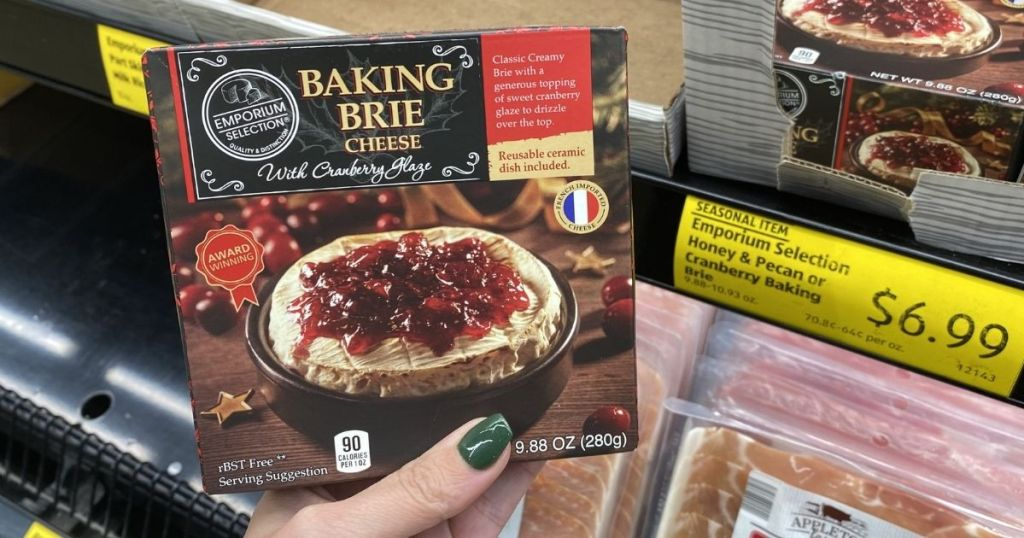 hand holding package of baking brie