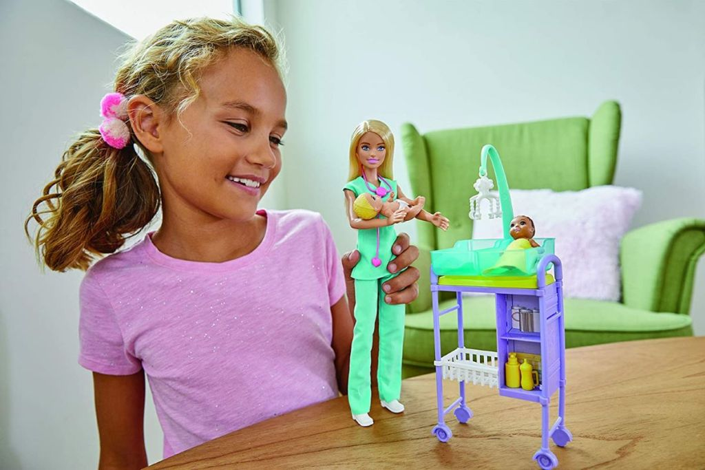 girl playing with a Barbie doctor set