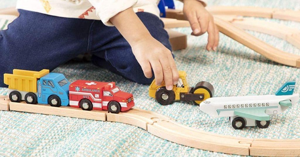 child playing with Battat Vehicles Set